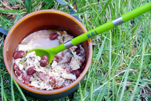 tuna and beans over campfire