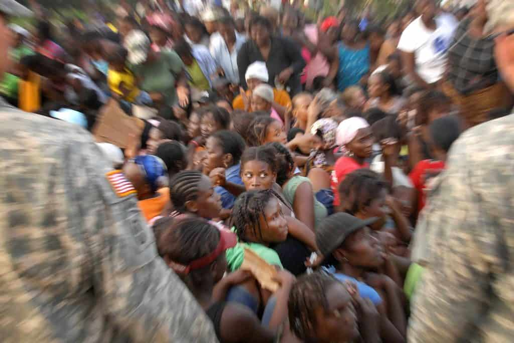 Masses fighting for supplies after the 2010 earthquake in Haiti
