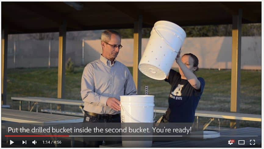 Put the holed bucket in the other bucket to wash