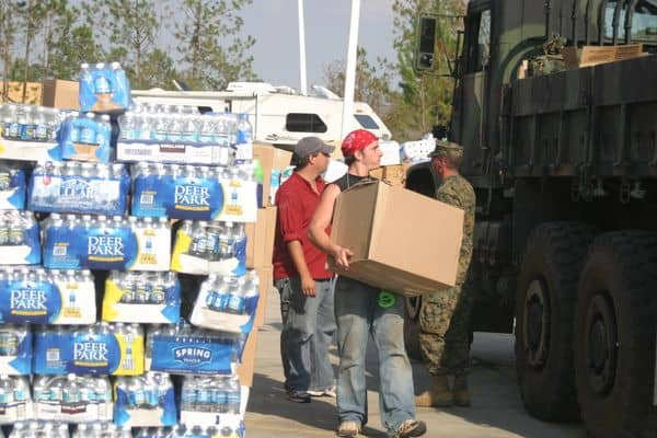 Relief workers loading water for hurricane Katrina victims