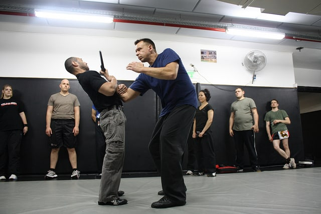 Practicing knife self defense in a Krav Maga class
