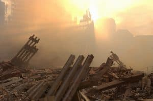 New York City, NY, September 13, 2001 -- The sun streams through the dust cloud over the wreckage of the World Trade Center.  Photo by Andrea Booher/ FEMA Photo News