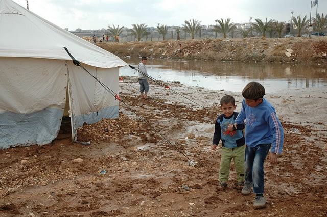 muddy refugee camp