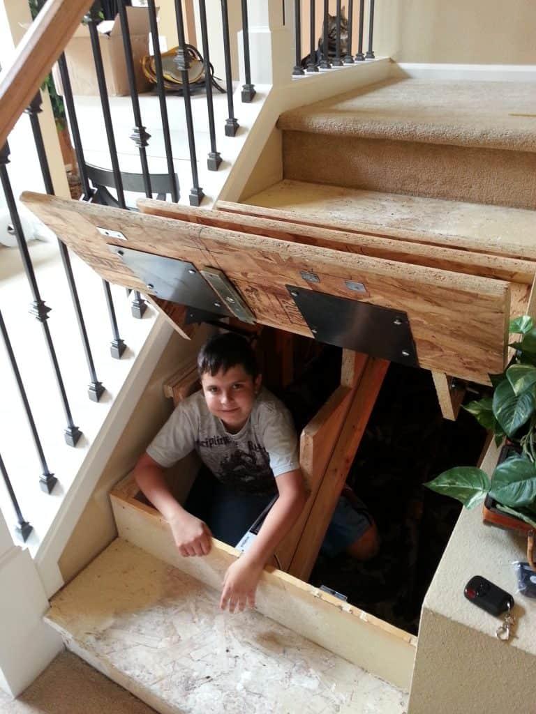 hidden compartment under stairs