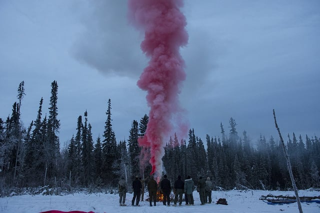 """Students at the Arctic """"Cool School"""" make a smoke signal"""