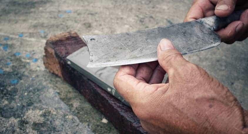 Sharpening knife on whetstone