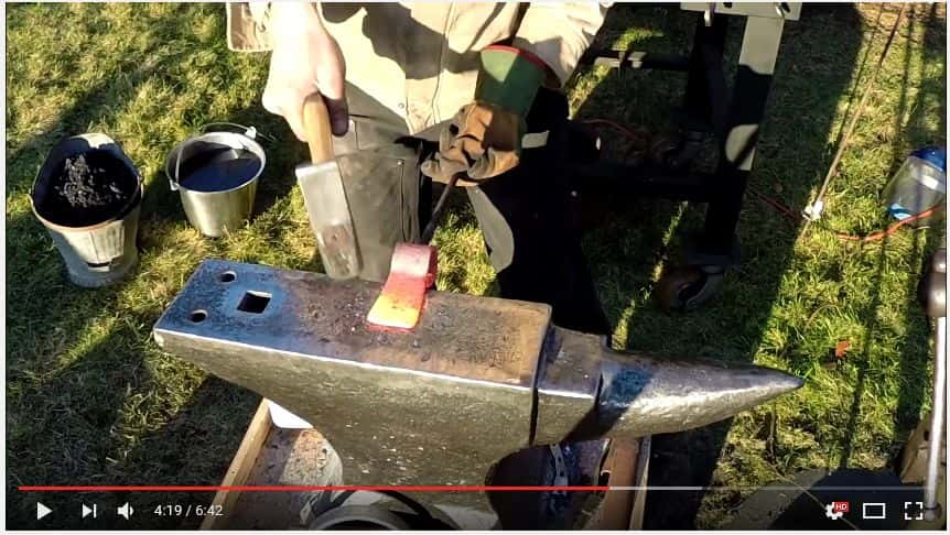 hammering sides of ax