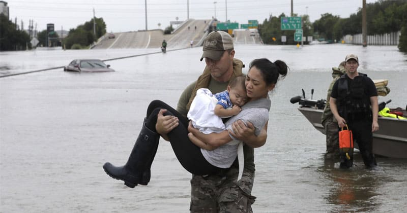disaster volunteer rescuing women and baby