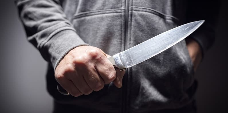 Man carrying knife