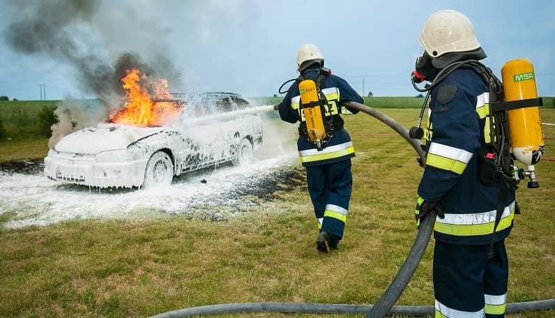 Automobile fire being extinguished