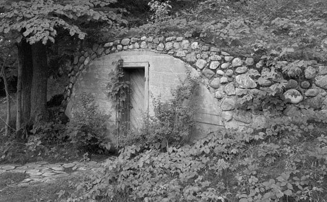 Outside of a root cellar built into a hill