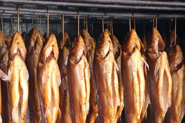 fish hung in smokehouse